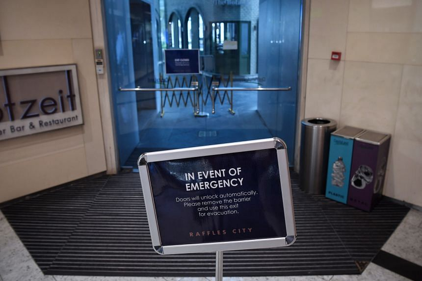 Buildings must have signs at exits clearly stating that barriers can be removed during a fire emergency.