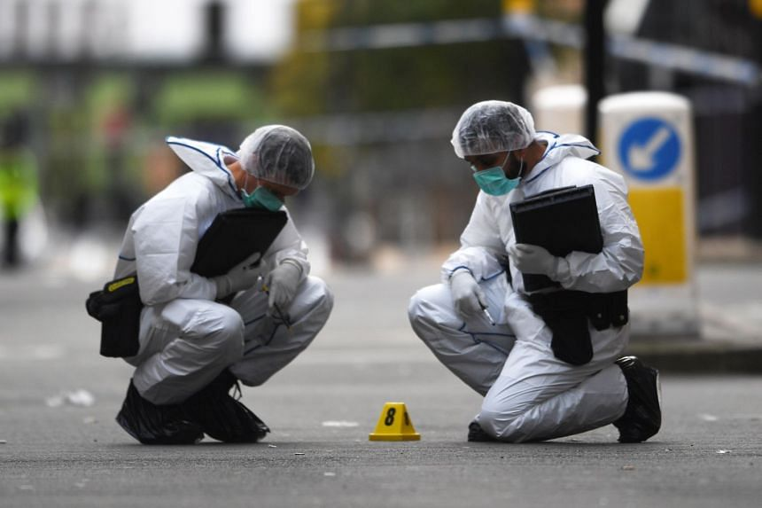 Forensics officers gather evidence at the scene of a mass stabbing in the centre of Birmingham,