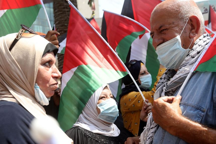 Palestinians protest against the UAE-Israel peace agreement in the West Bank city of Nablus, Sept 9, 2020.