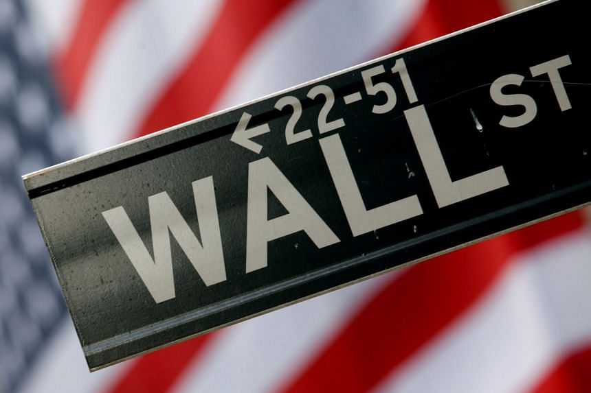 A street sign is seen in front of the New York Stock Exchange on Wall Street, New York.