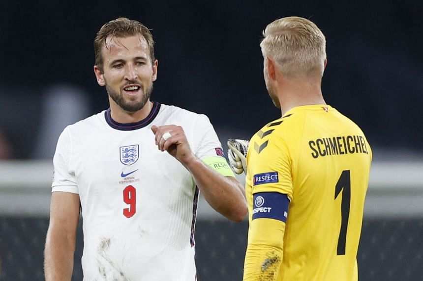 England's Harry Kane with Denmark's Kasper Schmeichel after the match.