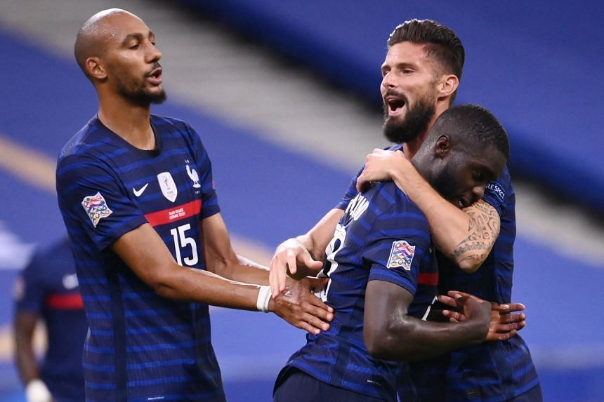 France's Dayot Upamecano (centre) celebrates a goal with Olivier Giroud (right) and Steven Nzonzi.