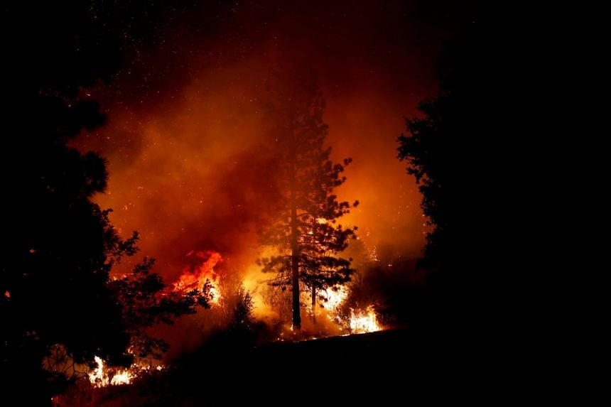 The Creek Fire in the Fresno area of central California grew overnight under extreme conditions
