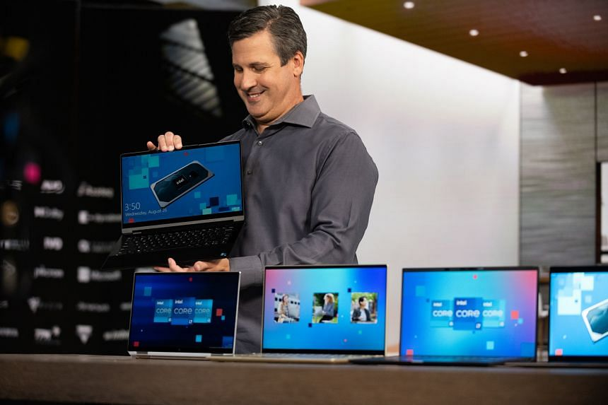 Mr Chris Walker, Intel's vice-president and general manager of Mobile Client Platforms, showing off new Intel Evo laptops from major PC brands.