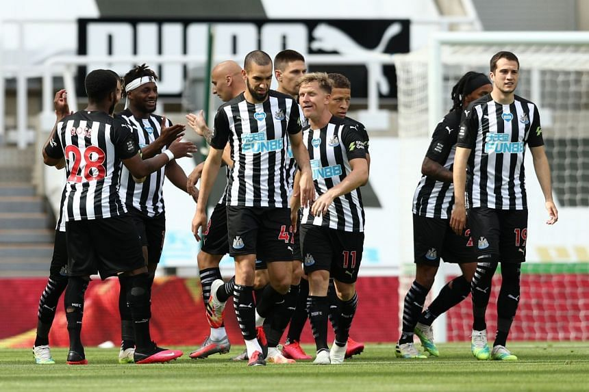 Newcastle United's Dwight Gayle celebrates a goal with teammates.
