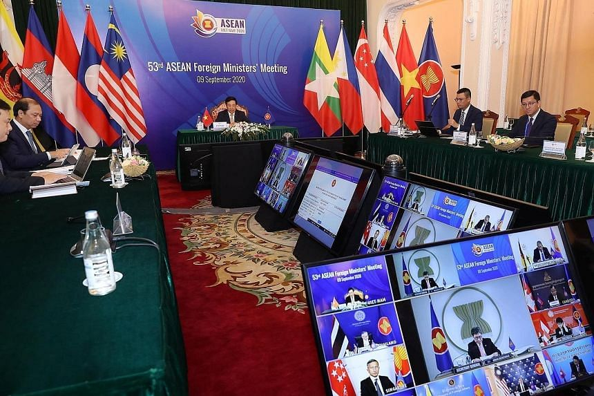 "Vietnam's Deputy Prime Minister Pham Binh Minh chairing the video meeting with Asean foreign ministers in Hanoi yesterday. Joining them are US Secretary of State Mike Pompeo and his Chinese counterpart Wang Yi, with the ""power rivalry"" between their"