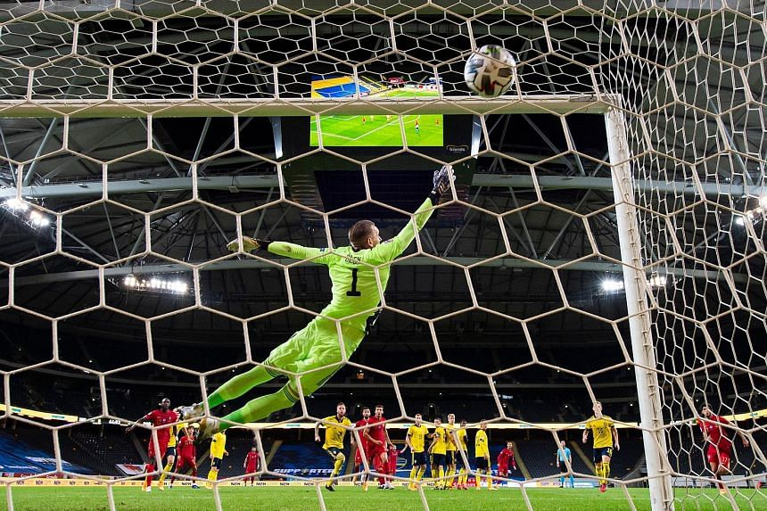 Sweden goalkeeper Robin Olsen grasping at thin air as Portugal forward Cristiano Ronaldo's strike finds the top corner of the goal. PHOTO: AGENCE FRANCE-PRESSE