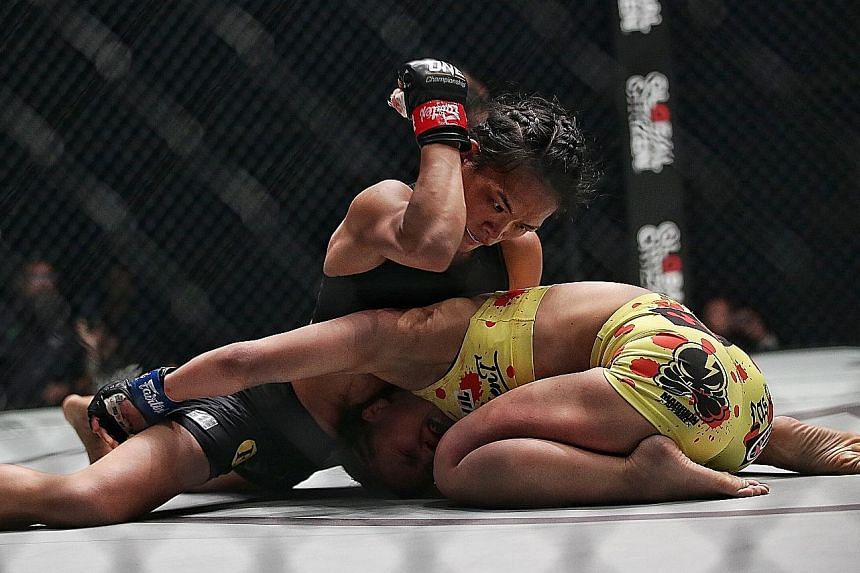 Local fighter Tiffany Teo throwing an elbow at Ayaka Miura of Japan in their strawweight bout in the last event by One Championship in February before the Covid-19 pandemic.