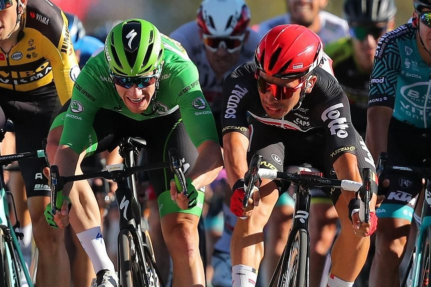 Caleb Ewan of Australia (in red helmet) and Sam Bennett of Ireland sprinting towards the line at the Tour de France in Poitiers yesterday. Ewan won the 11th stage, a 167.5km ride from Chatelaillon-Plage. Slovak Peter Sagan was second and Bennett thir