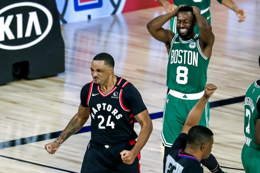 Toronto Raptors' Norman Powell (left) reacts to a foul called against Boston Celtics' Kemba Walker at the ESPN Wide World of Sports Complex in Florida on Sept 9, 2020.