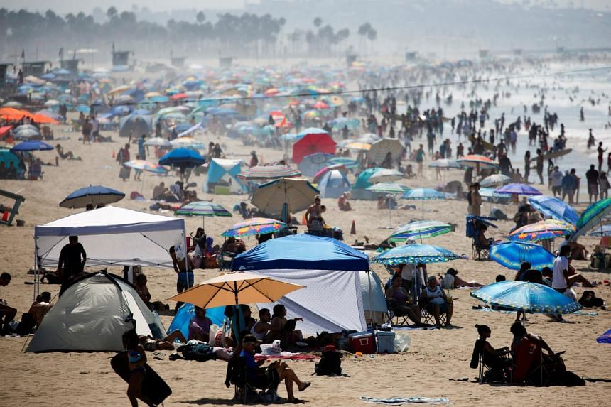 People crowd the beach during a record heat wave in Santa Monica, California, on Sept 6, 2020.