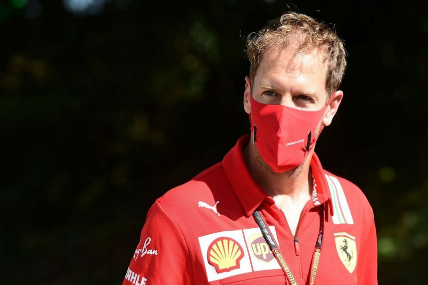 Vettel visits the track with team members ahead of the Italian Grand Prix.
