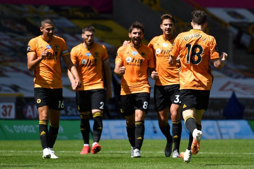 Wolverhampton players celebrate a goal against Everton in July 2020.
