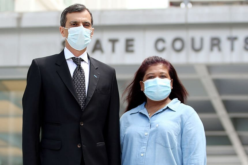 Ms Parti Liyani leaving the State Courts with her lawyer Anil Balchandani on Sept 8, after she was cleared of a fifth charge of fraudulent possession of property.