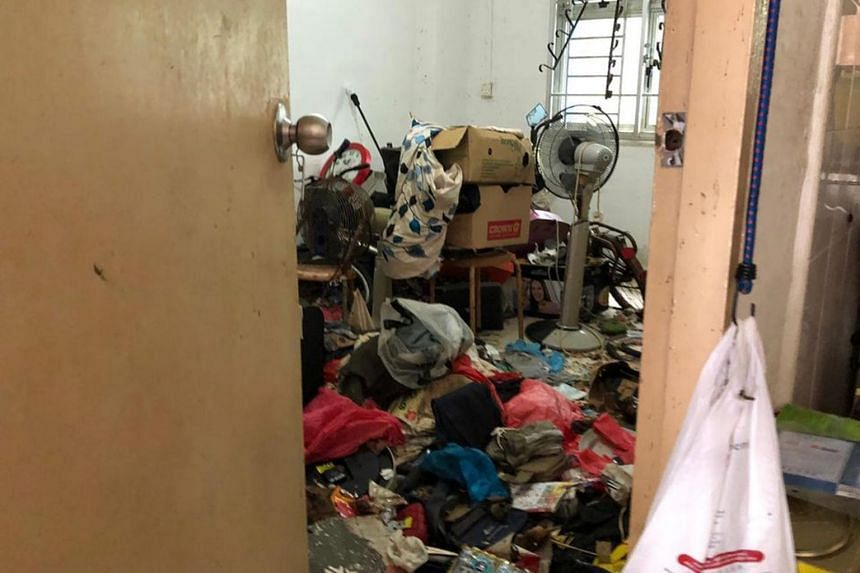 The two-room rental flat on the ground floor was so full of trash that volunteers could not get inside the unit.