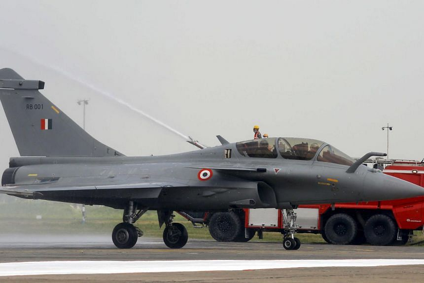 A French-made Rafale fighter being welcomed with a water jet arch at the Indian Air Force base in Ambala on Sept 10, 2020.