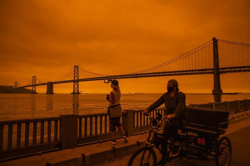 Smoke from various wildfires burning across Northern California shrouded San Francisco in darkness and an orange glow on Sept 9, 2020.