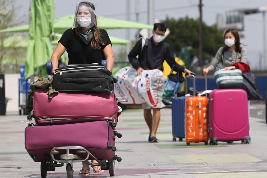 Air travellers arrive at the ride share lot at Los Angeles International Airport on Aug 20, 2020.