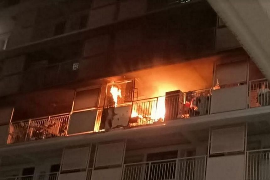 A woman in her 60s was rescued from the 13th-floor unit of Block 210A Bukit Batok Street 21 on Nov 1, 2019.