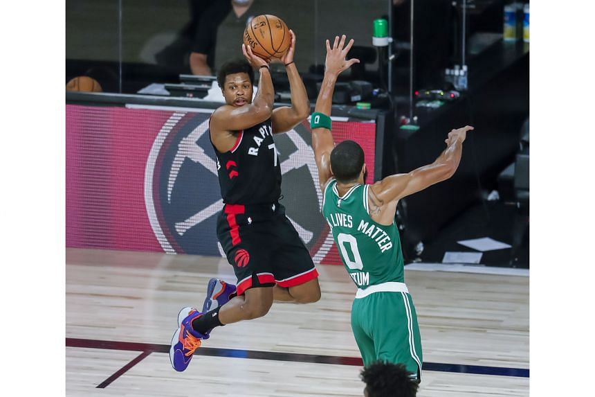 Raptors' Kyle Lowry looking for a way past Celtics forward Jayson Tatum. The Toronto guard finished with a game-high 33 points. PHOTO: EPA-EFE