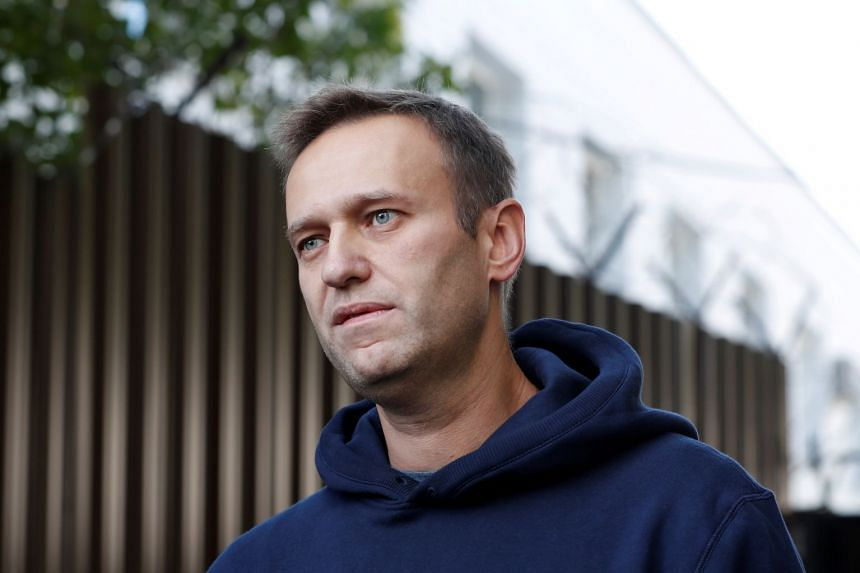 Russian opposition leader Alexei Navalny speaks to journalists in August 2019.