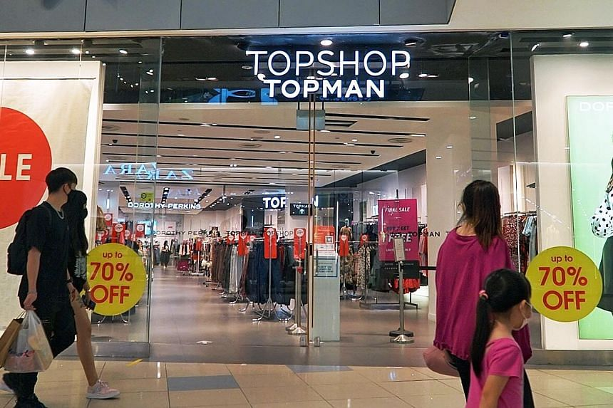 The Topshop and Topman outlet at VivoCity (above) will be closing for good next Thursday. Wing Tai Retail, brand manager for the two brands here, said its focus for them will be online. ST PHOTO: KHALID BABA