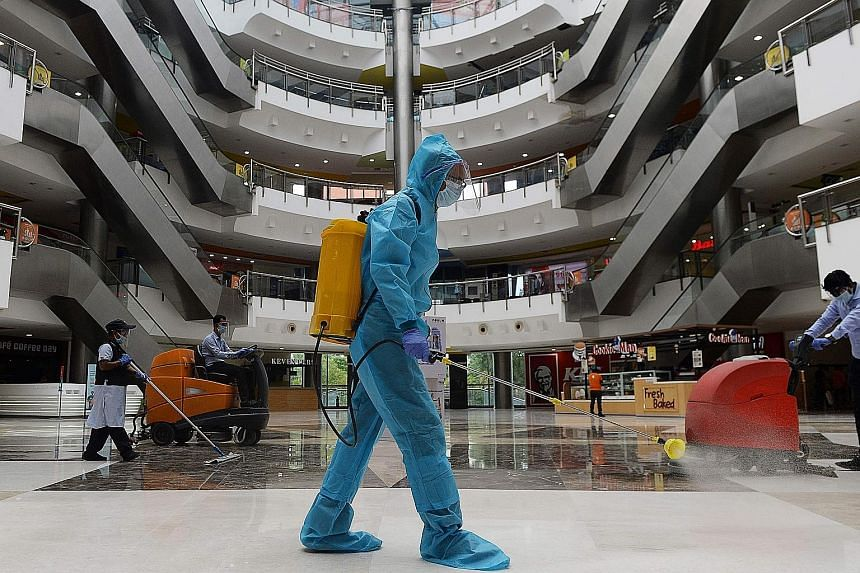 A worker sanitising the floor of a shopping mall in Chennai last week. Even as India has eased restrictions in a bid to protect and expand the economy, a business turnaround has not come because of rising numbers of coronavirus cases. PHOTO: AGENCE F