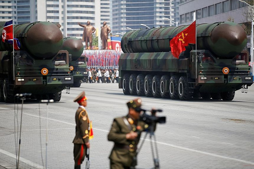 Intercontinental ballistic missiles on parade in Pyongyang in 2017. North Korea was singled out as an imminent threat by outgoing Japanese Prime Minister Shinzo Abe, who called for Japan's acquisition of first-strike capability on enemy missile bases