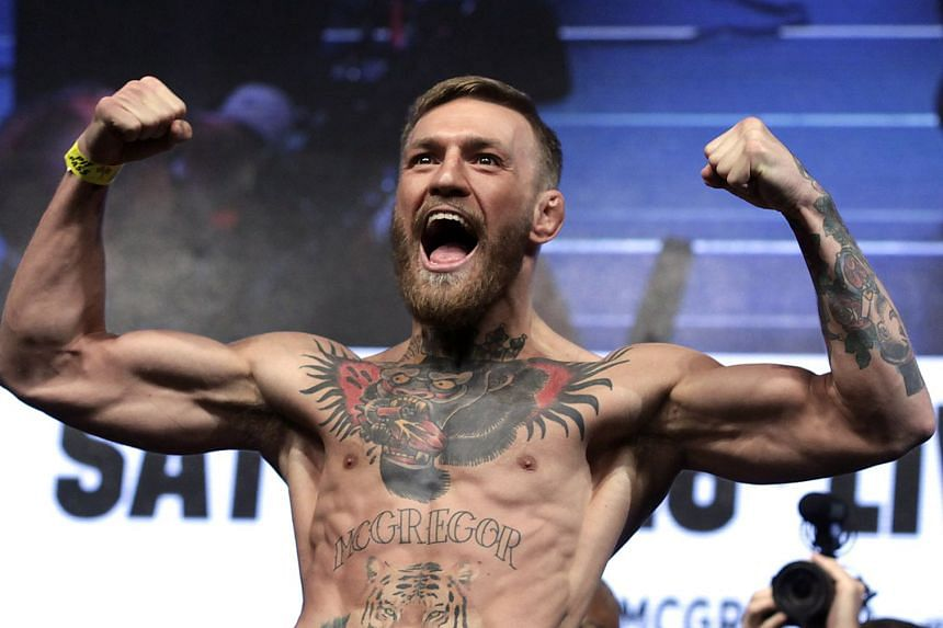 Mcgregor poses during a weigh-in, in Las Vegas, Nevada.