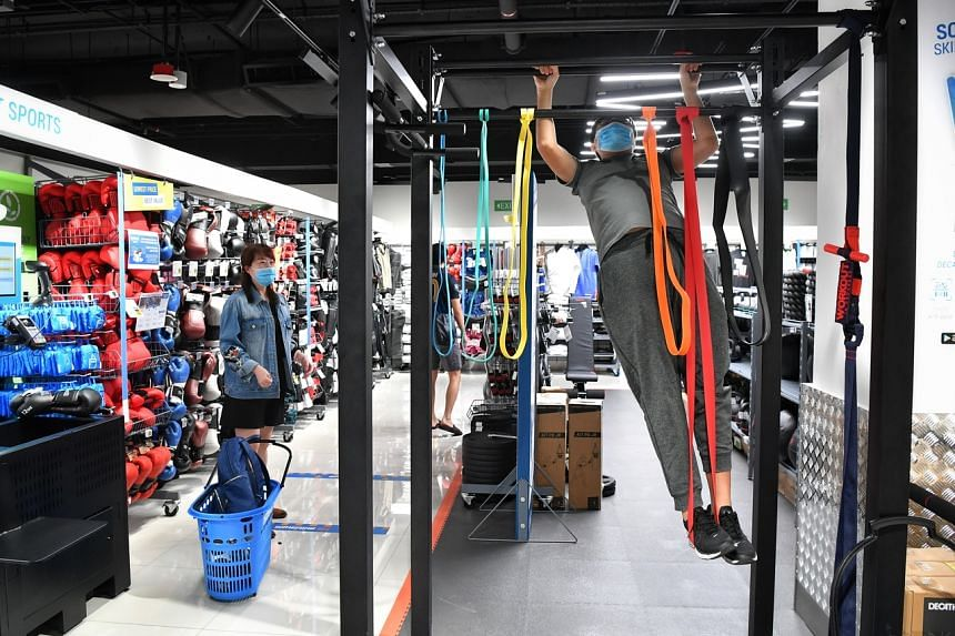 A customer doing a chin-up in the test zone at the Decathlon Orchard store.