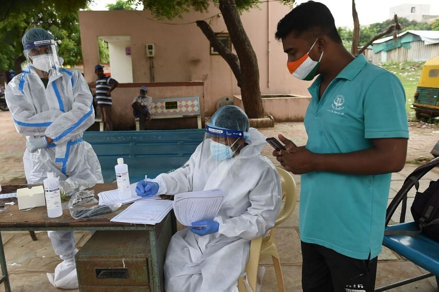 Health workers collect swab samples to test for the coronavirus in Ahmedabad on Sept 11, 2020.