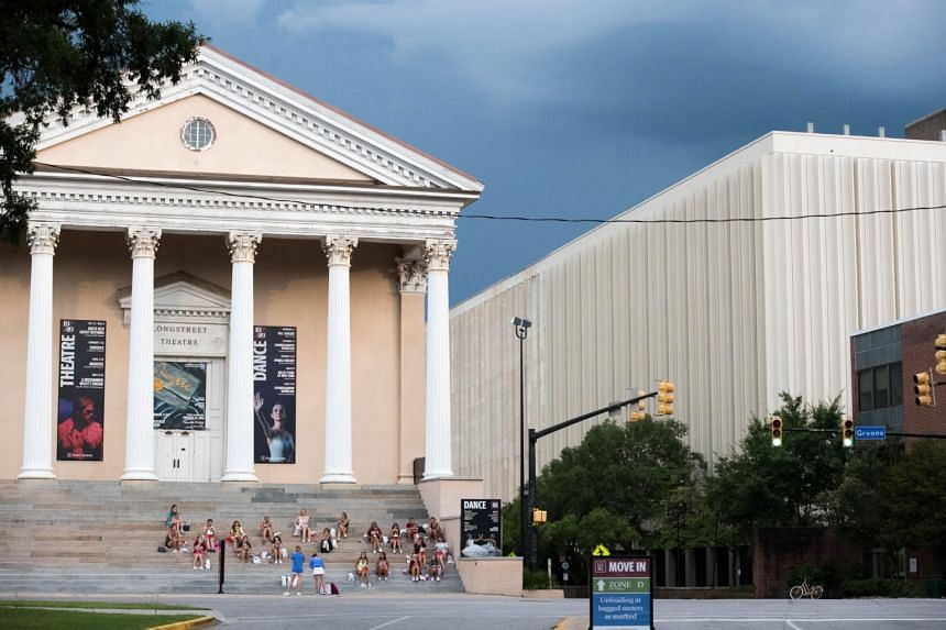 College students eat dinner at the Longstreet Theatre at the University of South Carolina on Aug 10, 2020.