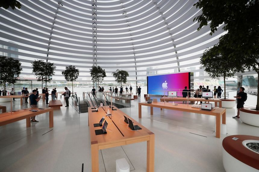 Customers at the Apple MBS store's opening on Thursday. The interior is a column-free space with a central video wall taking centre stage.