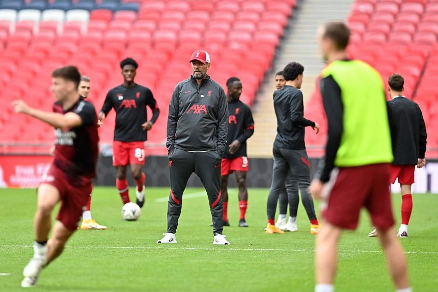 Liverpool manager Jurgen Klopp (looking on during their warm-up before the Community Shield match against Arsenal) is wary of Leeds' well-drilled side.