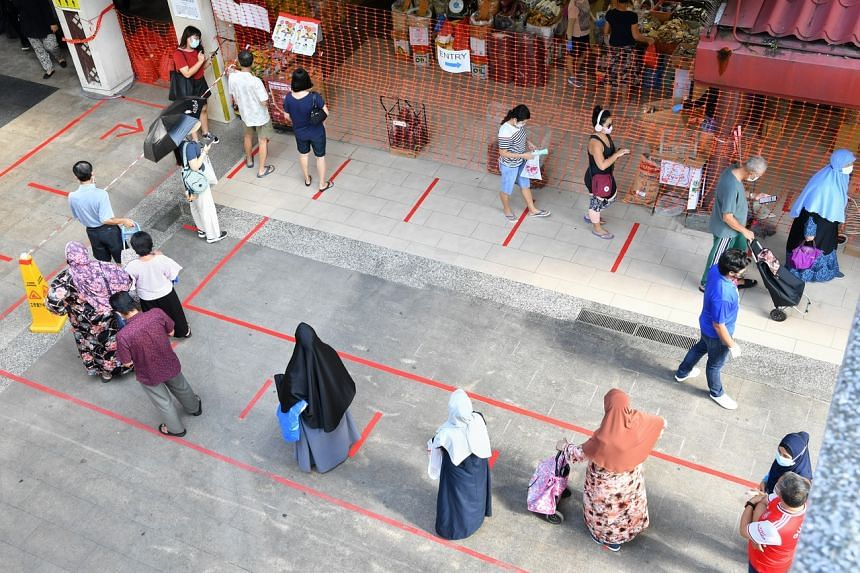 Long snaking queues formed outside Geylang Serai market on the morning of Sept 12, 2020.