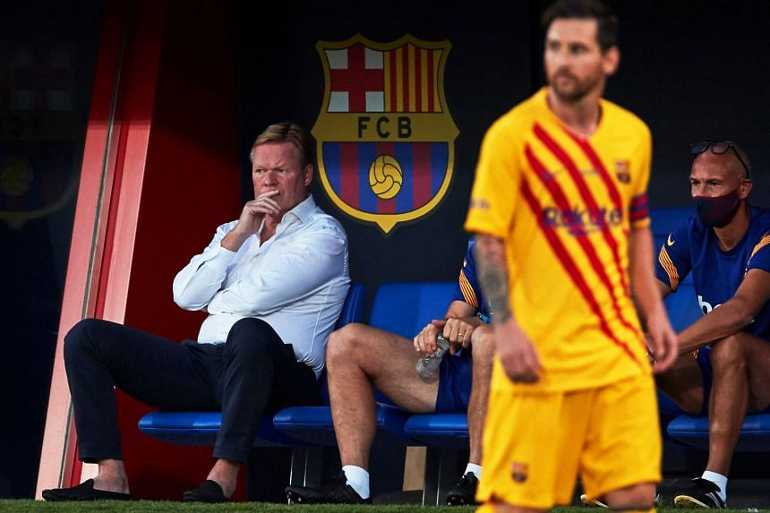Koeman (left) reacts next to Lionel Messi (right) during the pre-season friendly.