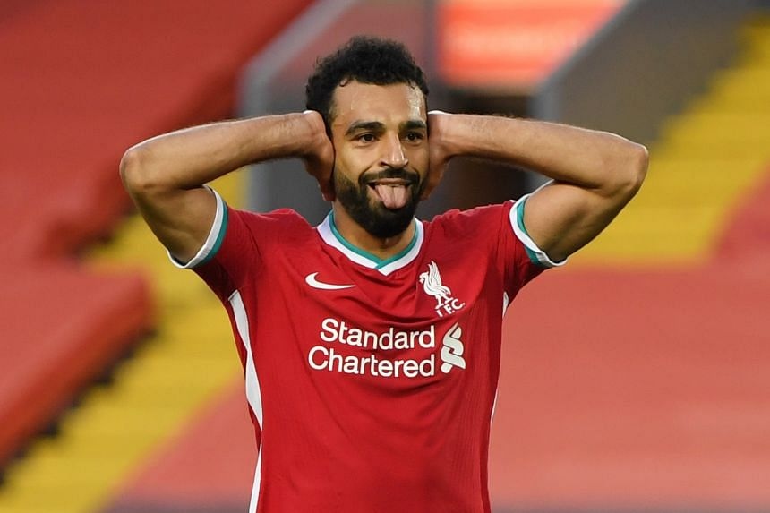 Liverpool's Salah celebrates scoring their fourth goal to complete his hat-trick.