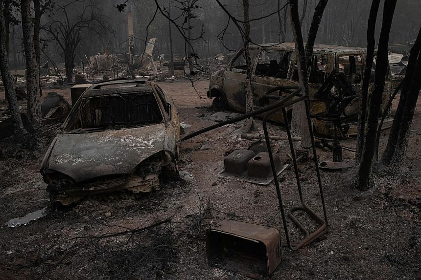 Razed vehicles in the aftermath of a blaze in Eagle Point Oregon. The firestorms have blanketed the skies over California Oregon and Washington state with smoke and ash
