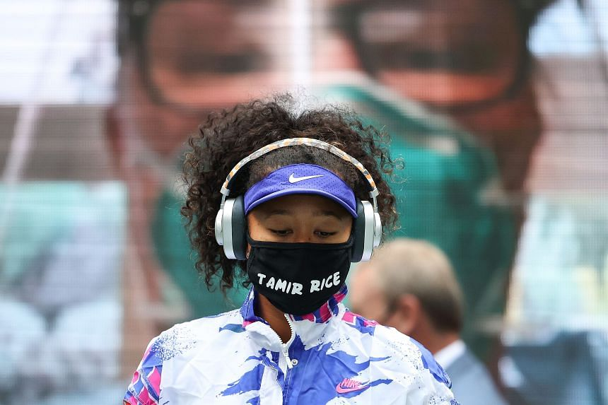 Naomi Osaka wearing a mask with the name of Tamir Rice, a 12-year-old black child who was holding a toy gun when a police officer shot and killed him in 2014.