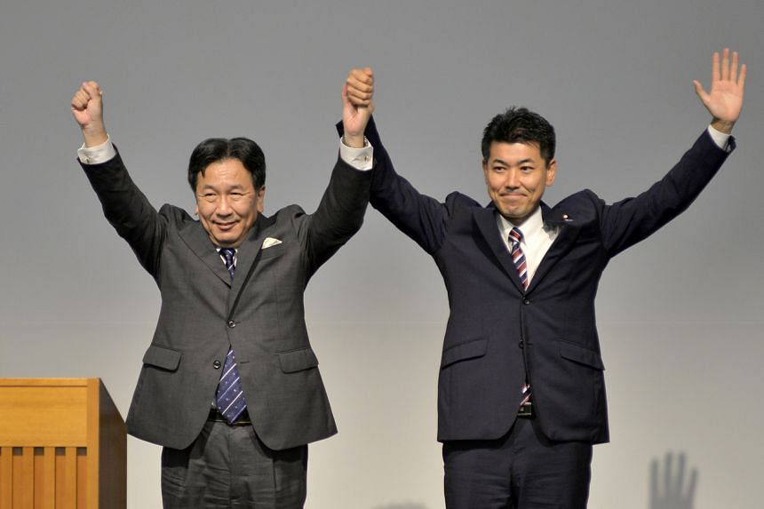 Constitutional Democratic Party chief Yukio Edano (left) with Democratic Party for the People policy chief Kenta Izumi after winning the leadership race for the major opposition party.