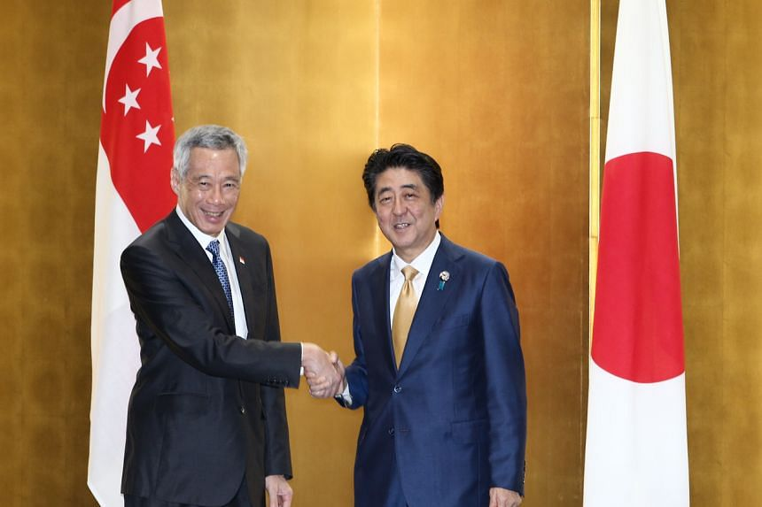 Japanese Prime Minister Shinzo Abe (right) welcomed Singapore Prime Minister Lee Hsien Loong upon his arrival at Osaka, Japan, in 2019.