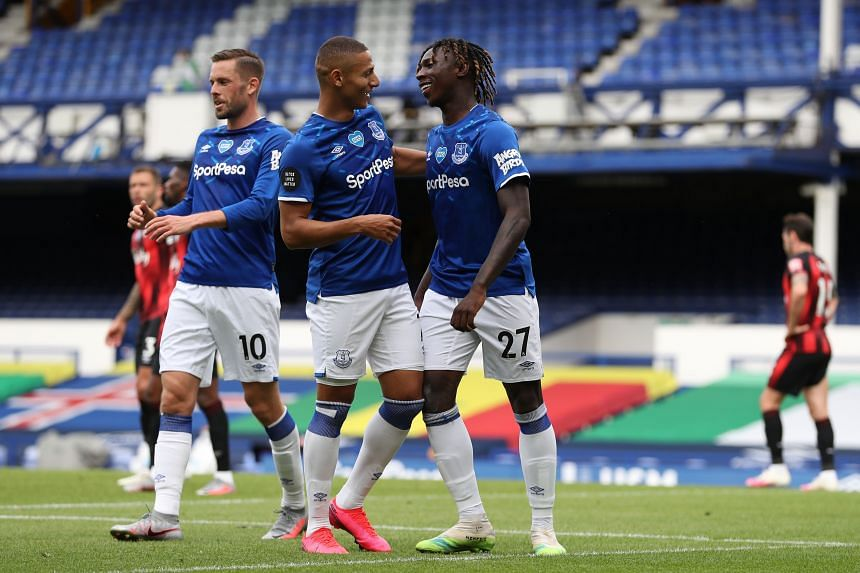 Everton's Italian midfielder Moise Kean (right) is congratulated by teammates in Liverpool, England, on July 26, 2020.