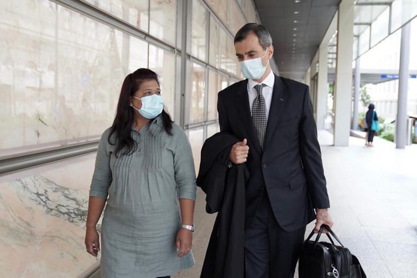Former domestic worker Parti Liyani and Mr Anil Balchandani leaving the Supreme Court building after she was acquitted.