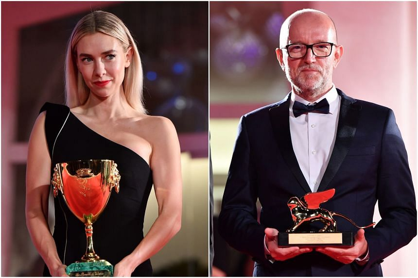 Disney's marketing director for Italy Davide Romani (right) receiving the Golden Lion for Best Film on behalf of US director Chloe Zhao for Nomadland, and Vanessa Kirby with the award for Best Actress.