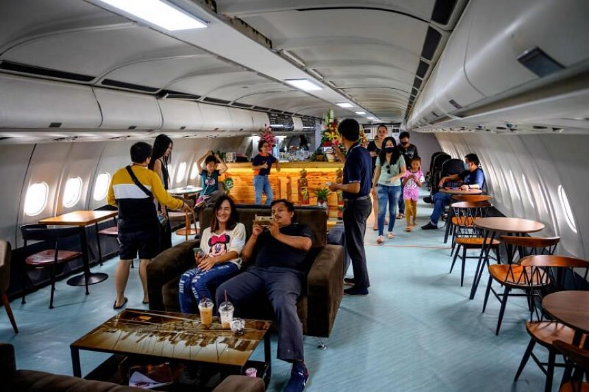 Visitors enjoying coffee in a retired Airbus A-330 plane in Pattaya, Chonburi province, on Sept 1, 2020.