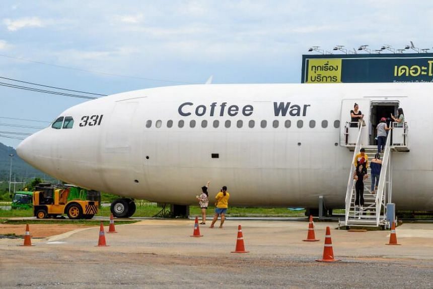 """""""Passengers"""" boarding the plane-turned-coffee shop in Pattaya, Chonburi province, on Sept 1, 2020."""