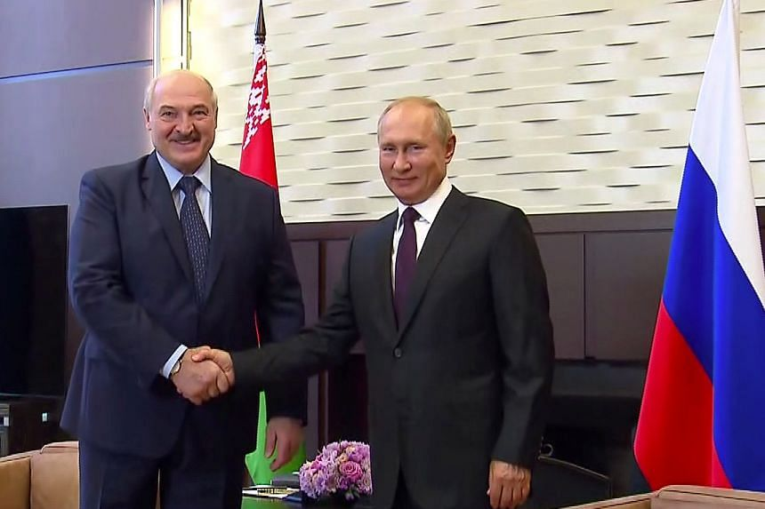 Russian President Vladimir Putin (right) shakes hands with his Belarusian counterpart Alexander Lukashenko during a meeting in Sochi, Russia, on Sept 14, 2020.