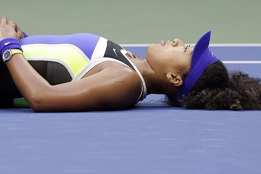 Enjoying a quiet moment after coming from behind to beat Victoria Azarenka for the US Open title on Saturday, Naomi Osaka can be proud that she has successfully channelled her sporting prowess to be a voice for social justice. PHOTO: EPA-EFE