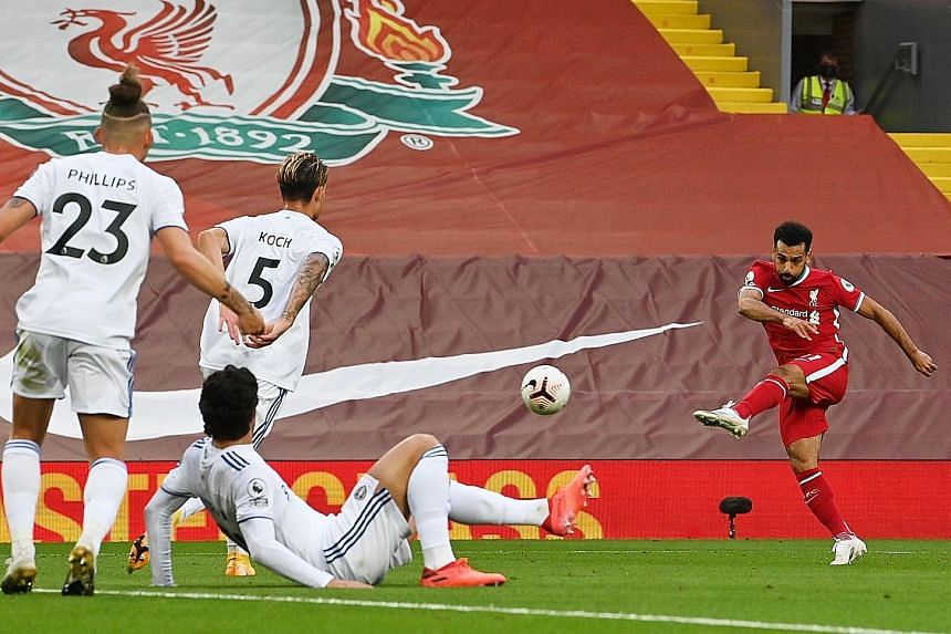 Mohamed Salah rifling in his second goal to put Liverpool 3-2 up. Leeds pegged back the Reds each time they led and it took the Egyptian's second penalty to give them full points. PHOTO: REUTERS