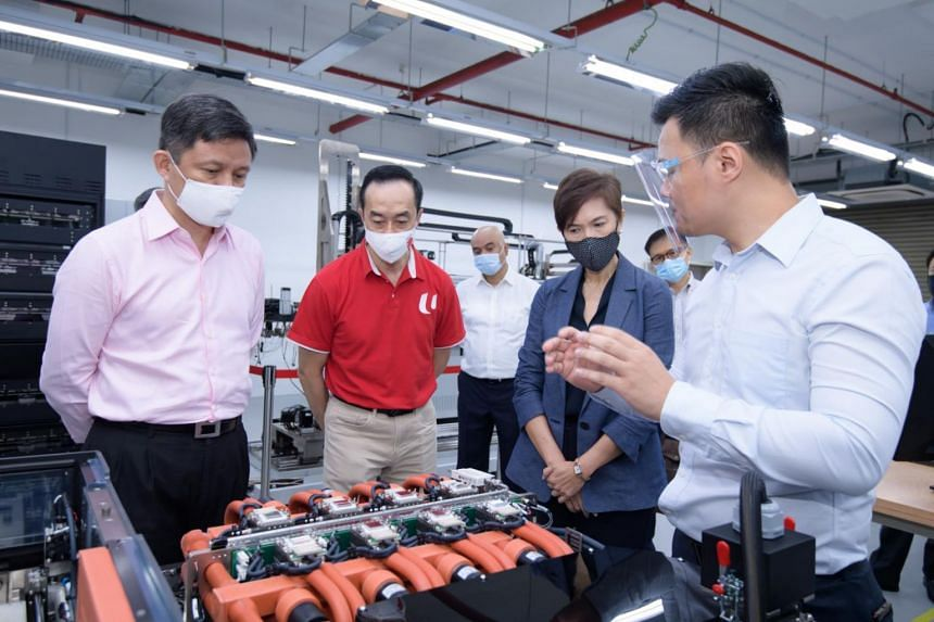(From left) Trade and Industry Minister Chan Chun Sing, NTUC deputy secretary-general Koh Poh Koon and Manpower Minister Josephine Teo at manufacturing firm AEM's facility in Serangoon North on Sept 14, 2020.
